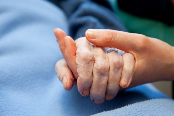 Image of carer holding hands
